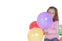Girl holding party balloons. Girl holding party baloons with blank space for text. Isolated on white Stock Image