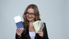 Girl is holding passport, plane ticket and money very rejoicing and enjoying, slow motion stock video footage