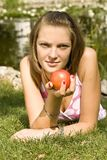 Girl holding a peach Stock Photos