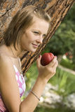Girl holding a peach Royalty Free Stock Photo
