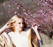 Girl holding peach branch Stock Images