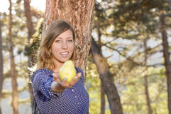 Girl holding a pear in the park Royalty Free Stock Photography