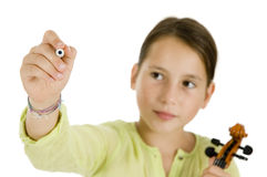 Girl holding a pen and a violin Stock Image