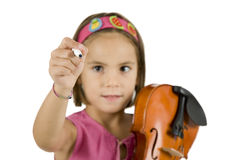 Girl holding a pen and a violin Stock Photos