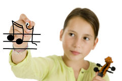 Girl holding a pen and a violin Stock Photography