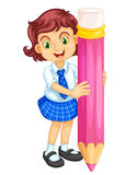 A girl holding pencil Stock Photo