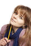 Girl holding a pencil Stock Image