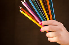 Girl holding a pencils Royalty Free Stock Photo
