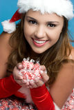 Girl Holding Peppermints Royalty Free Stock Image