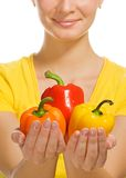 Girl holding peppers Stock Photo