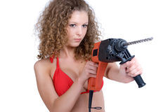 Girl holding perforator drill. Beautiful girl holding perforator drilll with big auger royalty free stock image