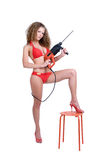 Girl holding perforator drilll and stool. Beautiful girl holding perforator drilll with big auger royalty free stock photography