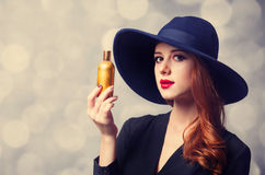 Girl holding perfume Stock Photo