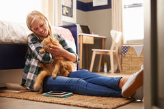 Girl holding pet cat in her bedroom Royalty Free Stock Image