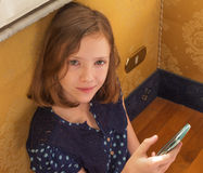 A girl holding the phone Royalty Free Stock Photo