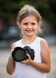 Girl  holding photo camera Royalty Free Stock Images