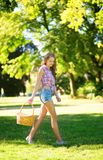 Girl holding a picnic basket Royalty Free Stock Images