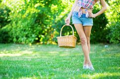 Girl holding picnic basket Royalty Free Stock Photos