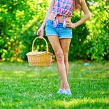 Girl holding picnic basket Royalty Free Stock Images