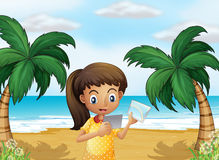 A girl holding pictures at the beach Royalty Free Stock Photography