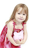Girl holding piggy bank. Portrait of a young girl holding a piggy bank.  White background Stock Images