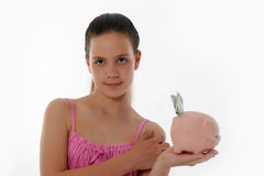 Girl Holding Piggy Bank Royalty Free Stock Image