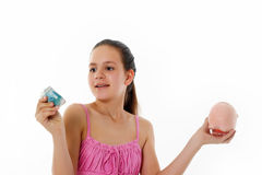 Girl Holding Piggy Bank Royalty Free Stock Photography
