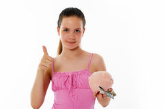 Girl Holding Piggy Bank Stock Photo