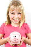 Girl Holding Piggy Bank Stock Photography