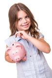 Girl holding piggy bank. Blonde cute girl holding pink piggy bank Royalty Free Stock Photos