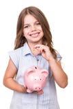 Girl holding piggy bank. Blonde cute girl holding pink piggy bank Stock Photography