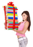 Girl holding pile of book. Royalty Free Stock Image