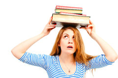 Girl holding pile of books over his head Stock Images