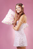 Girl holding pillow Royalty Free Stock Image