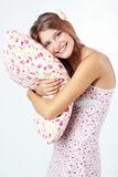 Girl holding pillow Royalty Free Stock Photography