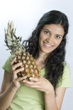 Girl holding pineapple Royalty Free Stock Images