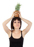 Girl holding pineapple over his head Stock Photography