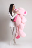 Girl holding pink bear Royalty Free Stock Photos