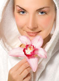 Girl holding pink orchid Royalty Free Stock Photo