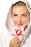 Girl holding pink orchid Royalty Free Stock Image