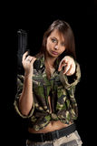 Girl holding pistol Royalty Free Stock Image