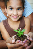 Girl Holding Plant stock images