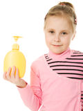 The girl is holding a plastic bottle Royalty Free Stock Photography
