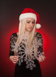 Girl holding plastic snowflake Stock Photography