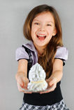 Girl holding plate of dessert Stock Photos