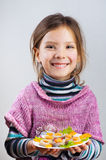 Girl holding plate of food Royalty Free Stock Photo