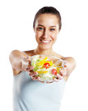 Girl holding plate with salad royalty free stock images