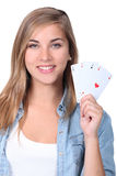 Girl holding playing cards Royalty Free Stock Image