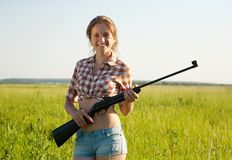 Girl holding pneumatic air rifle Royalty Free Stock Photos