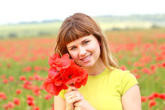 Girl holding poppy flowers Royalty Free Stock Photos